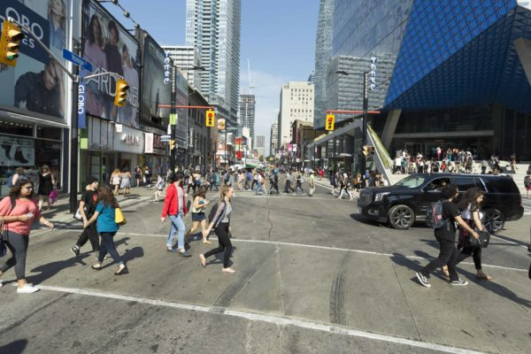 Busy street with cars and pedestrians