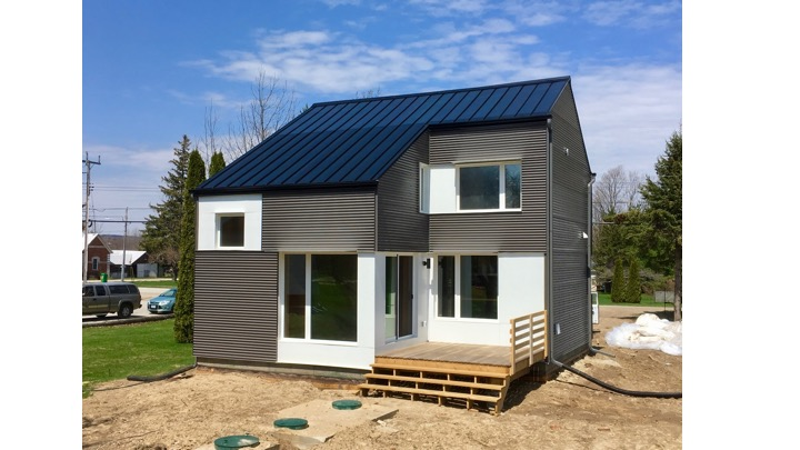 Photo of a small house just constructed.